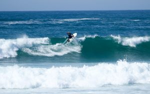 Surfer is doing a front side hit